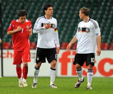Michael Ballack i Lukas Podolski /AFP