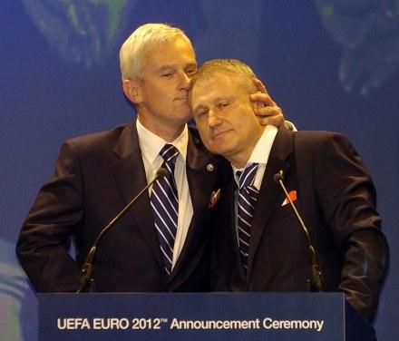 Michał Listkiewicz i Gregory Surkis /AFP