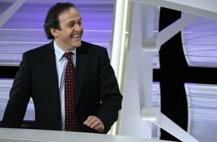Michel Platini głosował za Włochami /AFP