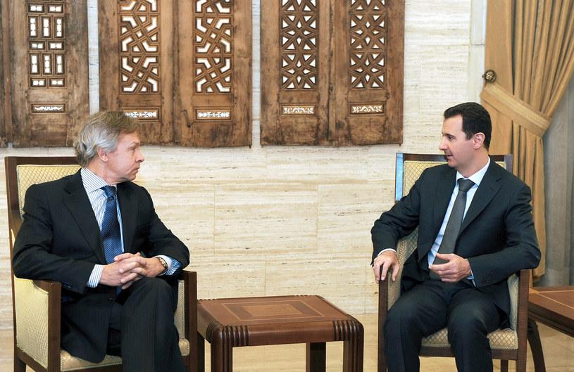 Na zdjęciu Aleksiej Puszkow (z lewej). Tu na spotkaniu z prezydentem Syrii Baszarem al-Asadem /HO/SANA /AFP