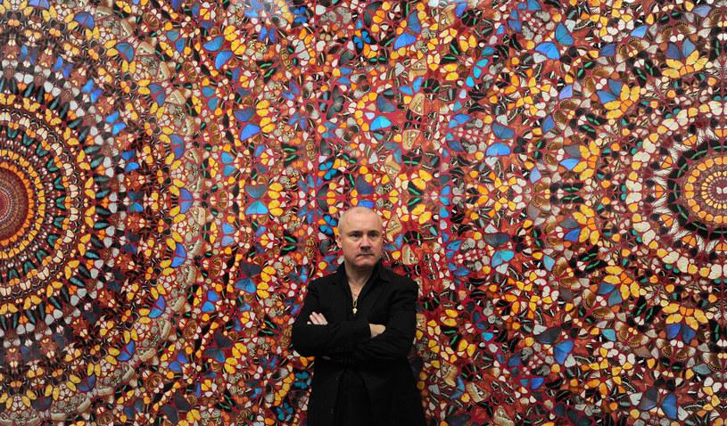 Na zdjęciu Damien Hirst przed jednym ze swoich obrazów /Carl Court /AFP