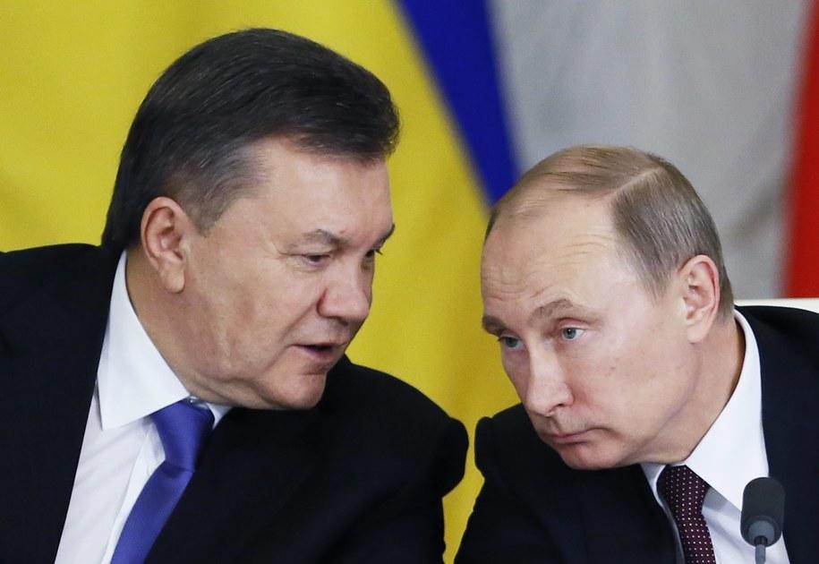 Na zdjęciu obalony prezydent Wiktor Janukowycz z Władimirem Putinem /YURI KOCHETKOV /PAP/EPA