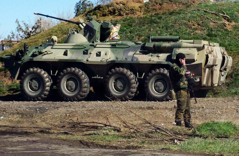 Na zdjęciu z marca 2014 rosyjscy żołnierze na Krymie /ALEXEY KRAVTSOV /AFP
