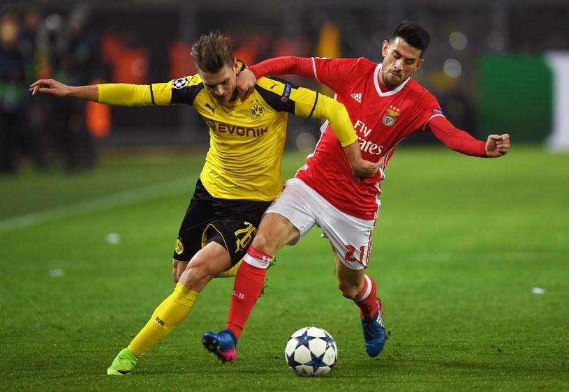 Obrońca Borussii Dortmund Łukasz Piszczek (z lewej) /AFP
