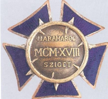 Odznaki pamiątkowe dla legionistów II Brygady internowanych na Węgrzech /Odkrywca
