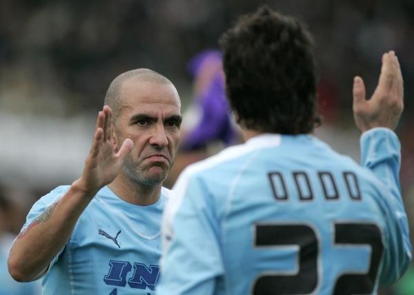 Paolo Di Canio i Massimo Oddo celebrują cenne zwycięstwo Lazio nad Sampdorią /AFP