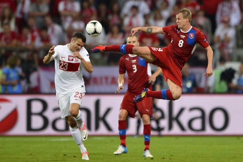 Paweł Brożek (z lewej) w meczu Polska - Czechy podczas Euro 2012. /AFP