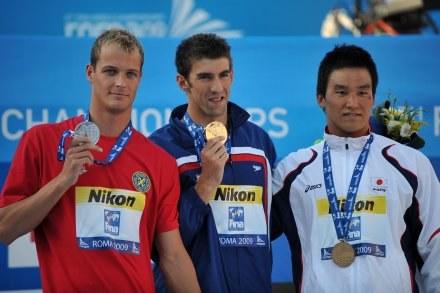 Paweł Korzeniowski, Michael Phelps i Takeshi Matsuda /AFP