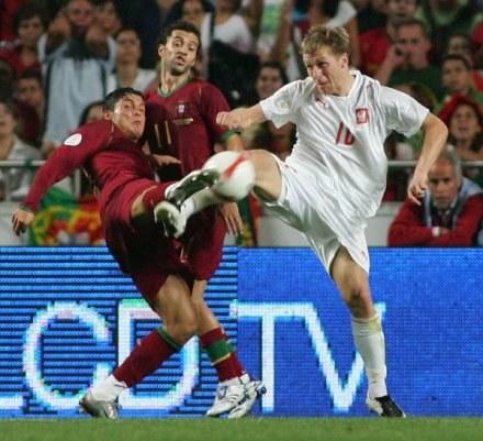 Pojedynki Kuby z Cristiano Ronaldo (za nimi Petit) były okrasą meczu, FOT. Marek Biczyk /Agencja Przegląd Sportowy