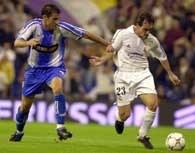 Real - Espanyol 5:1 - W pojedynku biegowym Alberto Lopo i  Pedro Munitis