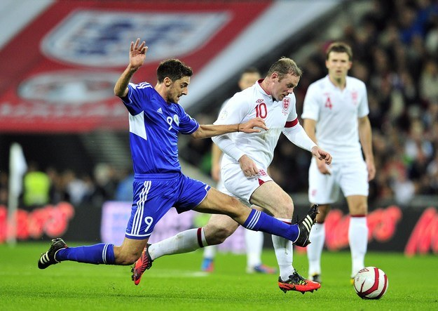 Rooney w piątkowym meczu z San Marino zdobył dwa gole /AFP