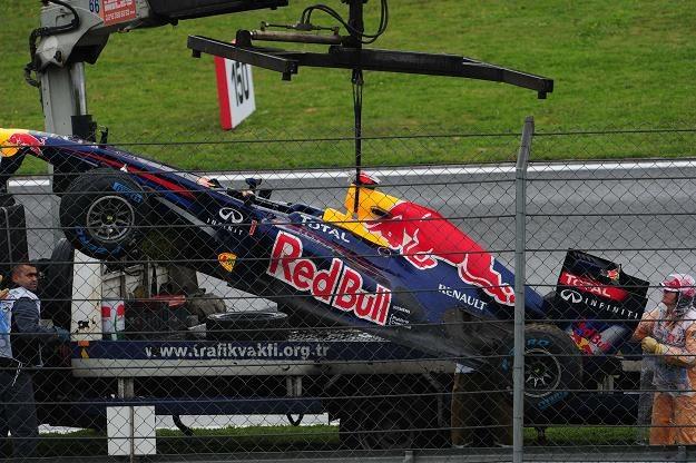 Rozbity bolid Vettela /AFP