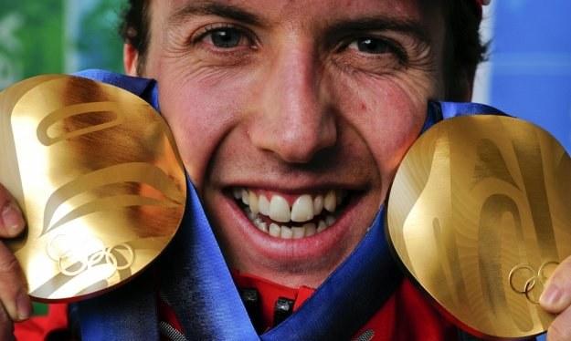 Simon Ammann indywidualnie wygrał już wszystko /AFP