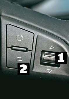 Skoda Układ przycisków typowy: obracając pokrętłem [1] wybieramy funkcje, akceptujemy je wciskając pokrętło, a wracamy - przyciskiem [2]. /Motor