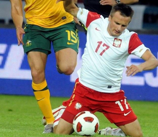Sławomir Peszko w meczu z Australią /AFP