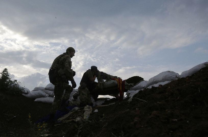 Strony konfliktu w Donbasie mogą być podejrzane o zbrodnie wojenne /AFP
