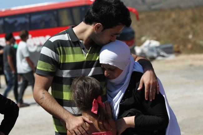 Syryjczycy uciekający z kraju do Izraela /ATEF SAFADI  /PAP/EPA