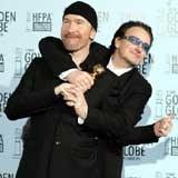 """The Edge i Bono (U2): """"A ty zostajesz ze mną"""" /AFP"""