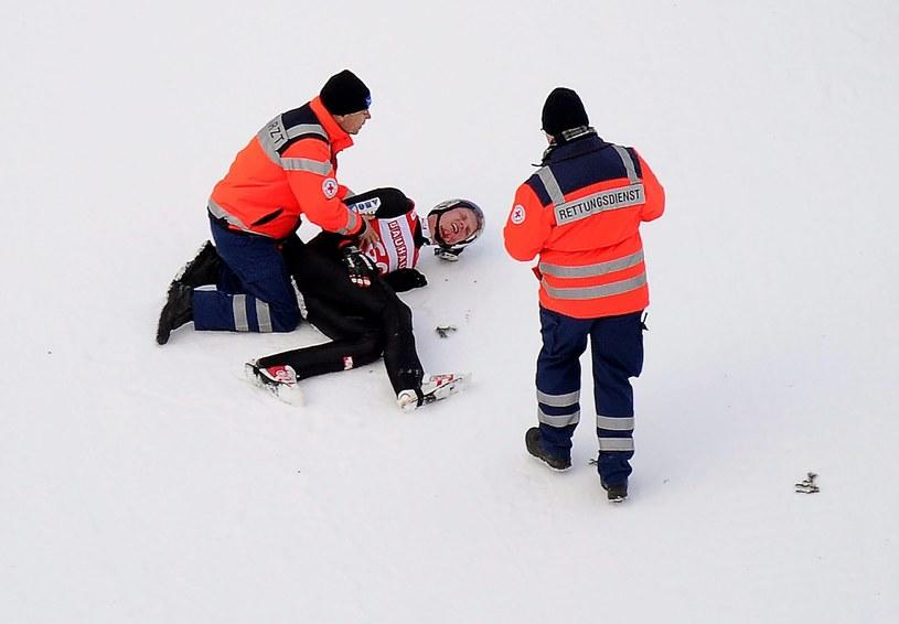 Thomas Morgenstern uderzył głową i barkiem w zeskok /PAP/EPA