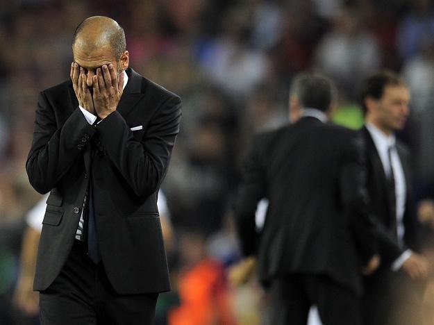 Trener FC Barcelona po utracie drugiego gola w meczu inaguracji Ligi Mistrzów z AC Milan /AFP