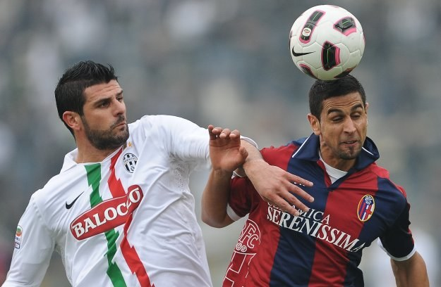 Vincenzo Iaquinta (z lewej) nie wykorzystał rzutu karnego /AFP