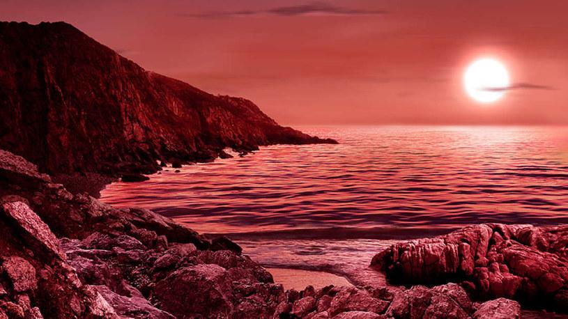 Wizja artystyczna planety krążącej wokół czerwonego karła /materiały prasowe