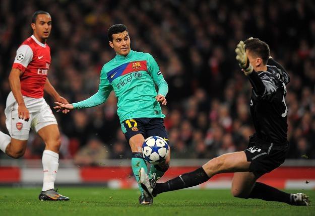 Wojciech Szczęsny (z prawej) w meczu Arsenalu Londyn z FC Barceloną (2-1) spisał się znakomicie /AFP
