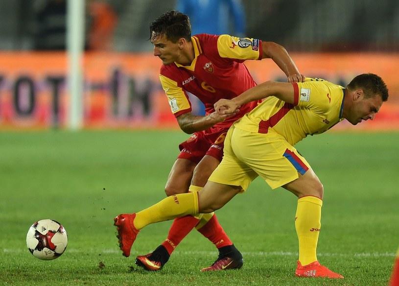 Żarko Tomasevicia (z lewej) zabraknie w meczu z Polską /AFP