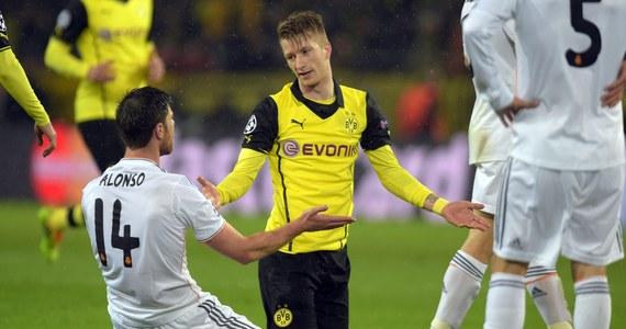 Piłkarze Borussii Dortmund - po porażce w Madrycie z Realem 0:3 - byli bliscy odrobienia strat w rewanżowym meczu ćwierćfinału Ligi Mistrzów, ale wygrali tylko 2:0. Oprócz hiszpańskiego zespołu awans wywalczyła Chelsea, po zwycięstwie 2:0 nad PSG.