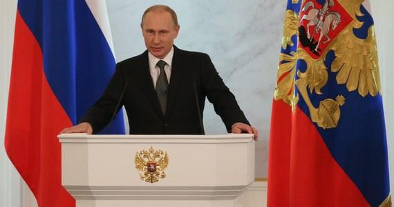 """Prezydent Rosji Władimir Putin powiedział, że jego kraj udowodnił w tym roku, że potrafi bronić swoich rodaków. Przyłączenie ukraińskiego Krymu do Federacji Rosyjskiej określił jako wydarzenie historyczne. """"Krym ma dla Rosji ogromne znaczenie cywilizacyjne, sakralne i strategiczne"""" - podkreślił."""