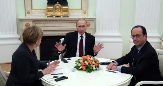 """Zakończyły się rozmowy przywódców Niemiec, Francji i Rosji na Kremlu poświęcone sprawie konfliktu na Ukrainie - poinformował w piątek wieczorem rzecznik Kremla Dmitrij Pieskow. Określił je jako """"konstruktywne"""" i dodał, że """"możliwe porozumienie dotyczące realizacji porozumień z Mińska jest w trakcie opracowywania""""."""