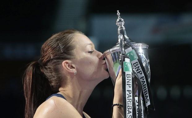 """Agnieszka Radwańska przyznała, że pierwszy w karierze triumf w kończącym sezon turnieju masters - WTA Finals - ma dla niej szczególną wartość. """"To najlepszy dzień w moim życiu"""" - podkreśliła wzruszona polska tenisistka po zwycięstwie w Singapurze."""