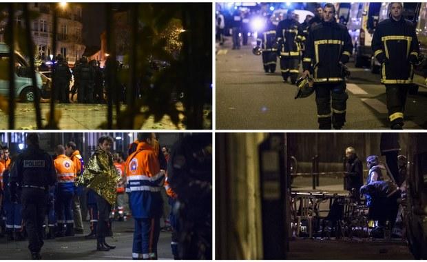 """To najbardziej krwawa seria zamachów terrorystycznych w historii Francji. Sprawdził się najgorszy scenariusz, którego obawiały się francuskie służby - tak prasa komentuje serię ataków terrorystycznych w Paryżu, w których zginęło - według władz miasta - co najmniej 128 osób, a około 200 zostało rannych. Do zamachów oficjalnie przyznało się Państwo Islamskie. Za atakami mogła stać konkretnie grupa Francuzów, którzy wyjechali wcześniej do Syrii. Dziś dżihadyści opublikowali nagranie, na którym grożą kolejnymi atakami we Francji. Prezydent tego kraju oświadczył, że paryskie zamachy to """"akt wypowiedzenia wojny"""" państwu i wartościom, których Francja broni na całym świecie. Szef naszego MSZ podkreśla, że resort nie ma żadnych informacji, iż w zamachach mógł zginąć Polak, ale sprawa jest rozwojowa. ABW otrzymała zaś od francuskich służb specjalnych tajny raport, z którego wynika, że obecnie nie ma zagrożenia terrorystycznego dla Polski. Ale jak ustalił nasz reporter, wojewoda mazowiecki wydał decyzję o wzmocnieniu ochrony placówek dyplomatycznych w Polsce, a także obiektów związanych z Francją. Polskie MSW na bieżąco weryfikuje sytuację. Zwiększono monitoring przylotów i wylotów z kierunków potencjalnie zagrożonych - podał resort w komunikacie. Wydarzenia w Paryżu śledzimy w relacji minuta po minucie."""