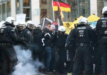 Antyimigrancki marsz w Kolonii: Poleciały petardy i butelki, policja odpowiedziała armatkami wodnymi