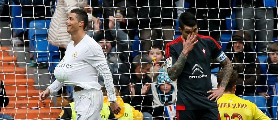 """Real Madryt pokonał Celtę Vigo 7:1, a Cristiano Ronaldo zdobył cztery gole i objął prowadzenie w klasyfikacji strzelców hiszpańskiej ekstraklasy piłkarskiej. W tabeli """"Królewscy"""" jednak nadal zajmują trzecią lokatę, za Barceloną i lokalnym rywalem - Atletico."""