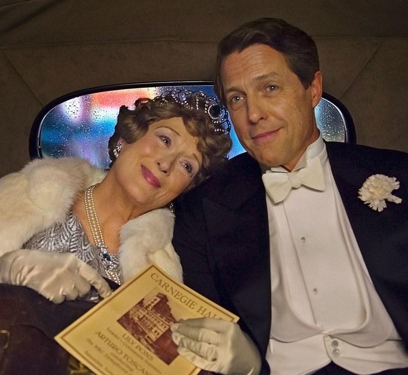 """W """"Boskiej Florence"""" Meryl Streep - zdobywczyni trzech Oscarów, jedna z największych aktorek naszych czasów - wciela się we Florence Jenkins nazywaną """"najgorszą śpiewaczką świata"""". W roli jej partnera i menedżera jak zwykle czarujący Hugh Grant."""