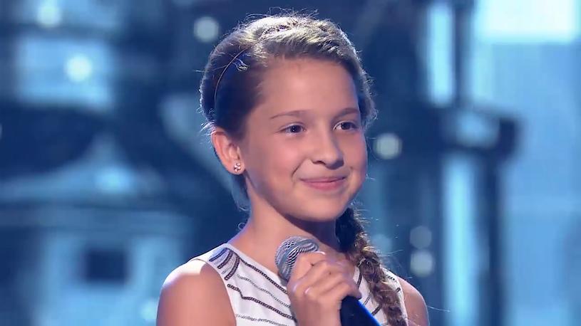 """W ostatnim odcinku (28 września) programu """"Hit, Hit, Hurra!"""" jedną z najlepiej ocenionych uczestniczek została Zuzia Polańska. 11-latka swoim wykonaniem przeboju """"Mam tę moc"""" z filmu """"Kraina Lodu"""" podbiła serce Edyty Górniak."""