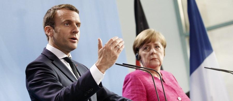 """""""Nie zawahamy się wziąć udziału w debacie o zmianie traktatu"""" - tak polski MSZ komentuje zapowiedzi kanclerz Niemiec i prezydenta Francji. I podkreśla, że Polska stara się doprowadzić do reformy Unii wykorzystując dyskusję na temat Brexitu. Angela Merkel i Emmanuel Macron, w czasie pierwszej wizyty prezydenta Francji w Berlinie, zapowiedzieli zmiany, które miałyby przede wszystkim wzmocnić strefę euro."""