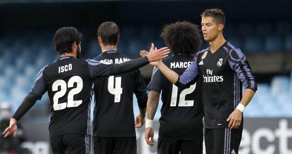 Piłkarze Realu Madryt pokonali na wyjeździe Celtę Vigo 4:1 (1:0) w zaległym meczu hiszpańskiej ekstraklasy i są blisko wywalczenia mistrzowskiego tytułu. Na kolejkę przed zakończeniem sezonu wyprzedzają drugą w tabeli Barcelonę o trzy punkty.