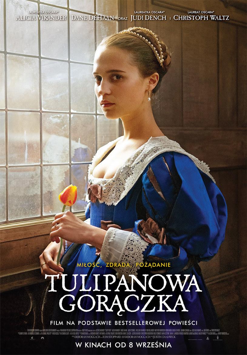 """Burzliwy romans """"Tulipanowa gorączka"""", zrealizowany na podstawie bestsellerowej powieści autorstwa Debory Moggach, na nasze ekrany trafi 8 września. Film, z udziałem Christopha Waltza (""""Spectre"""", """"Django""""), Alicii Vikander (""""Dziewczyna z portretu"""", """"Ex-Machina""""), Judi Dench (""""Skyfall"""", """"Tajemnica Filomeny""""), Zacha Galifianakisa (""""Kac Vegas"""") i Cary Delevingne (""""Papierowe miasta""""), to jedna z najbardziej oczekiwanych premier tej jesieni."""
