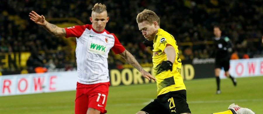 Tysiące kibiców Borussii Dortmund zbojkotowało zakończony remisem 1:1 mecz tego zespołu z Augsburgiem w 24. kolejce niemieckiej ekstraklasy piłkarskiej. To protest przeciwko rozgrywaniu spotkań w poniedziałki. Od pierwszej do ostatniej minuty grał Łukasz Piszczek.