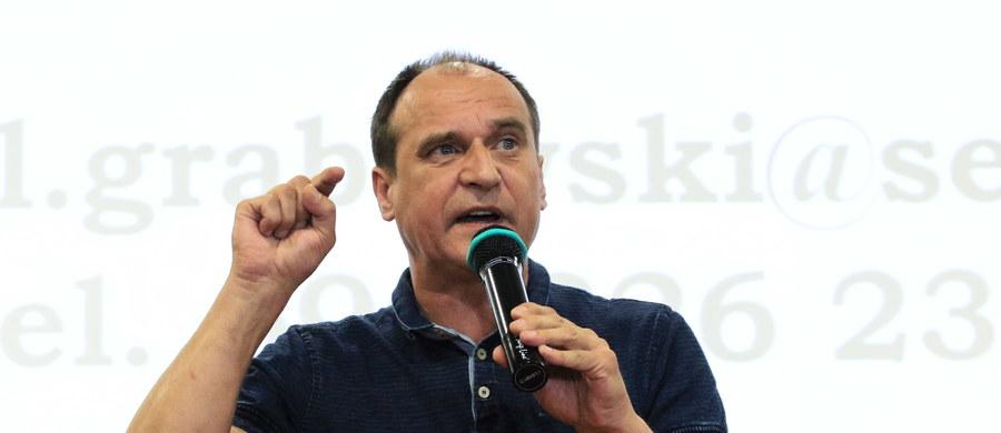 """Lider Kukiz'15 Paweł Kukiz jest zadowolony z zapowiedzi Roberta Biedronia dotyczących utworzenia nowej inicjatywy politycznej. Jak ocenił, """"w ogromnej mierze osłabia ona całą lewą stronę"""" polityczną."""
