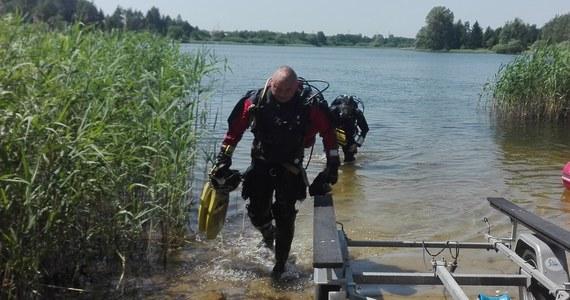 """Nurkowie z Fundacji """"Na Tropie"""" od kilku dni szukają w Jeziorze Dywickim koło Olsztyna ciała zaginionej w 1996 roku Joanny Gibner. Na razie bezowocnie. 23-letnia dziewczyna została zamordowana. Dwóch mężczyzn, którzy mogą znać miejsce ukrycia zwłok, nie chce współpracować z poszukiwaczami."""