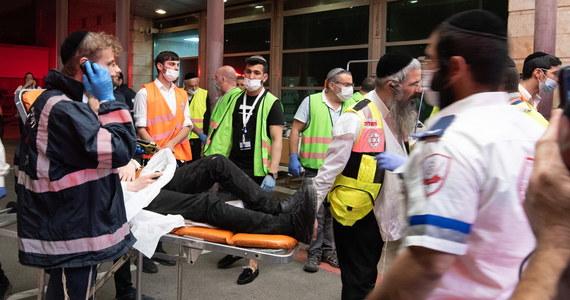 """Ludzie modlili się i krzyczeli, że nie mogą oddychać, było niewyobrażalnie tłoczno - powiedział dziennikowi """"Israel Hajom"""" 22-letni Mandi, uczestnik święta ultraortodoksyjnych Żydów na górze Meron w Galilei. W nocy z zginęło tam co najmniej 45 osób, w tym dzieci, a 150 zostało rannych."""