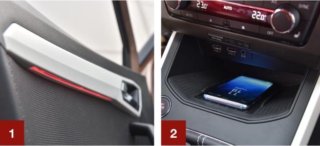 [1] Testowana wersja seryjnie ma podświetlenie drzwi (czerwone/białe). [2] Półka wzmacnia sygnał GSM i bezprzewodowo ładuje telefon (2168 zł w pakiecie z nawigacją). /Motor