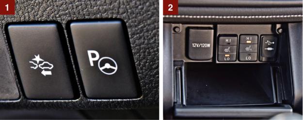 [1] Układ automatycznego hamowania w razie wykrycia przeszkody i asystent parkowania. Oba seryjne. [2] Przyciski ogrzewania foteli to jedyne, do których trzeba sięgać – ukryto je w schowku pod panelem klimatyzacji. /Motor