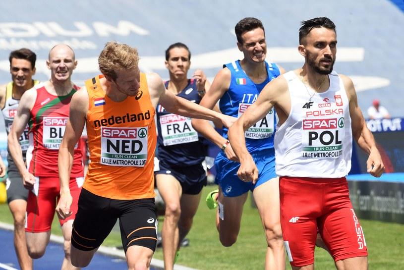 Adam Kszczot wygrał bieg na 800 m, ale został zdyskwalifikowany /AFP
