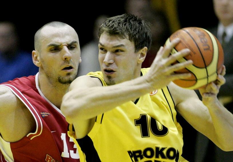 Adam Wójcik i Marcin Gortat /AFP