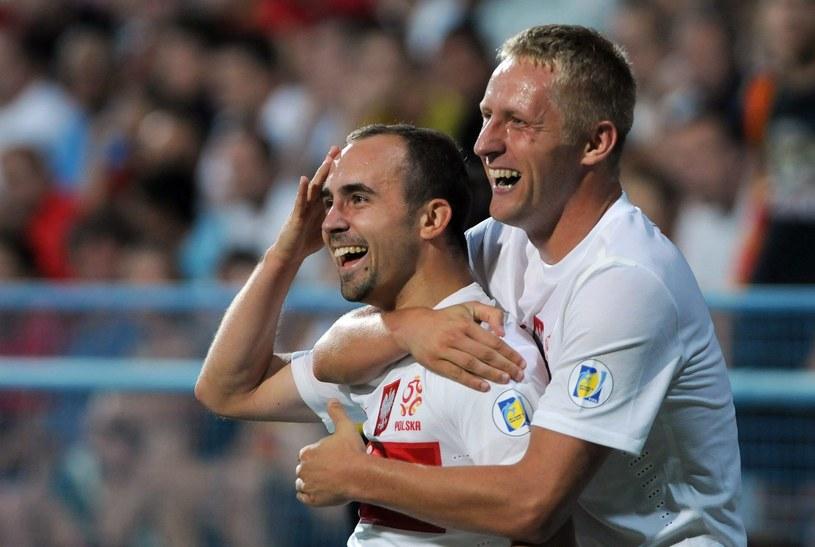 Adrian Mierzejewski i Kamil Glik /AFP