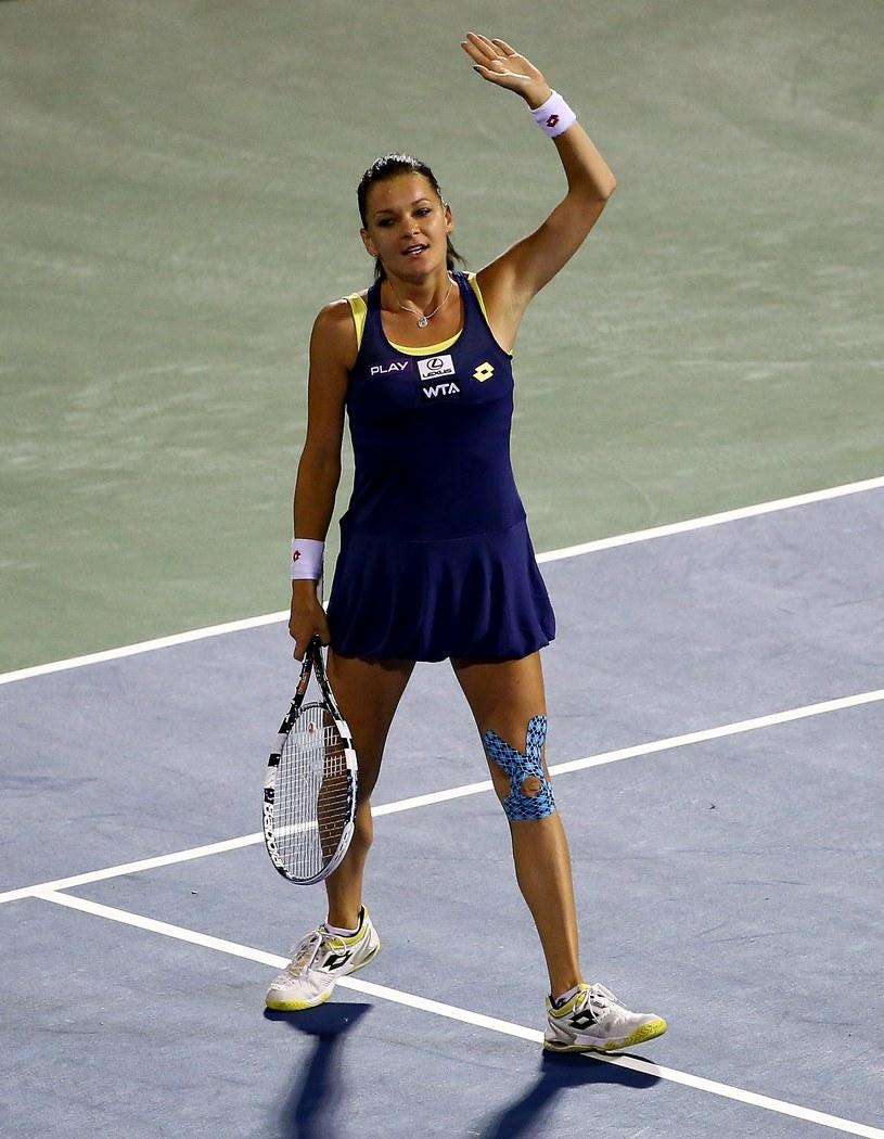 Agnieszka Radwańska cieszy się po zwycięstwie z Wiktorią Azarenką /AFP